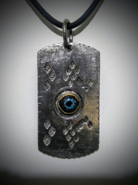 Eye of the Serpent - Stainless steel, enamel, brass, titanium bail